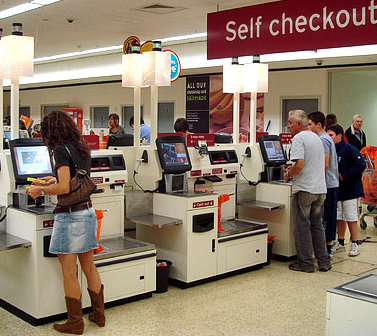 woman using self checkout gif